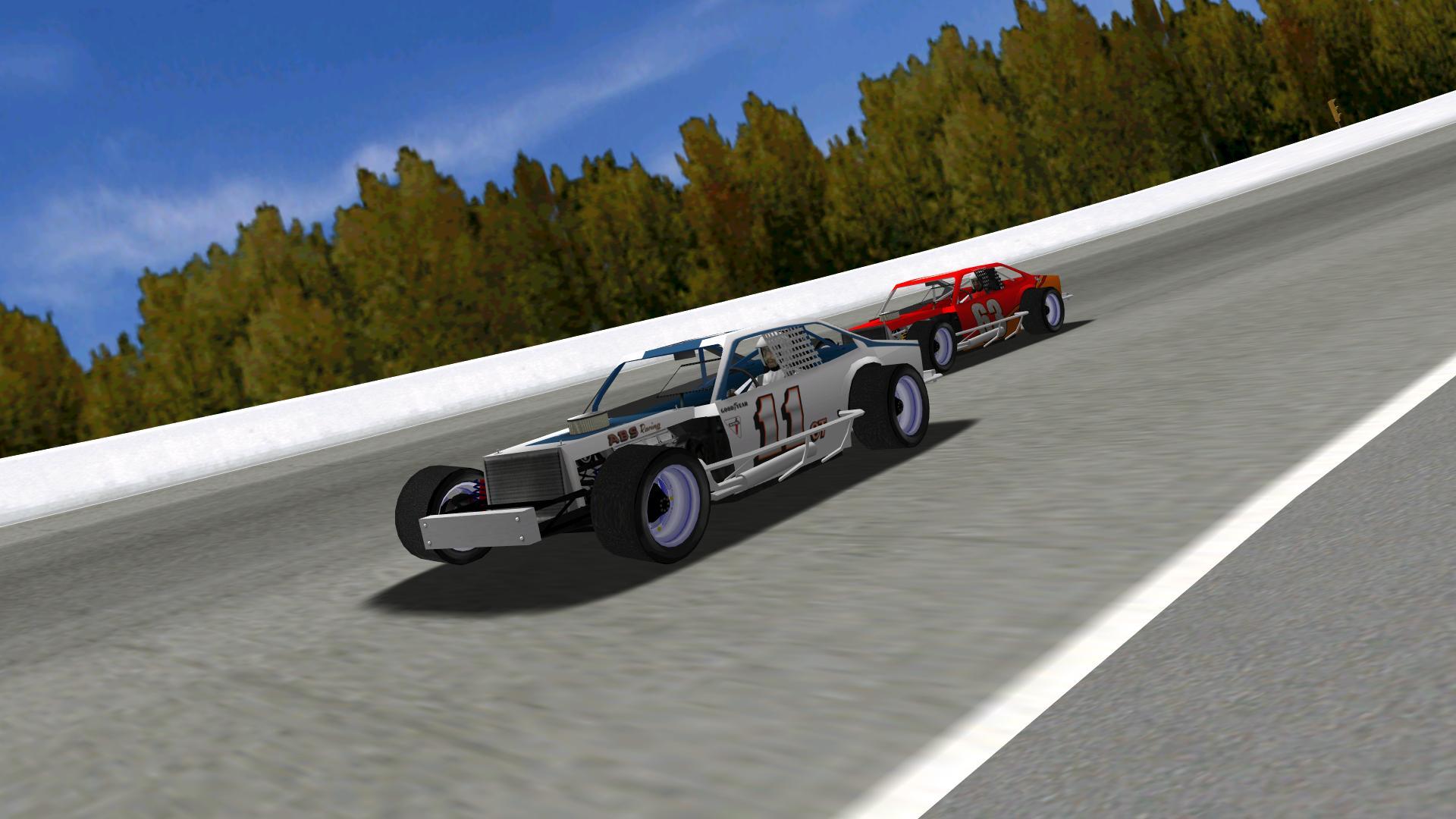 Speedyman11 passing KartRacer63 in turn one. (NHMA)