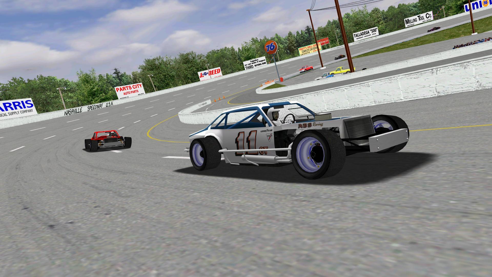 Speedyman11 leading KartRacer63 through turn four at Nashville. (NHMA)