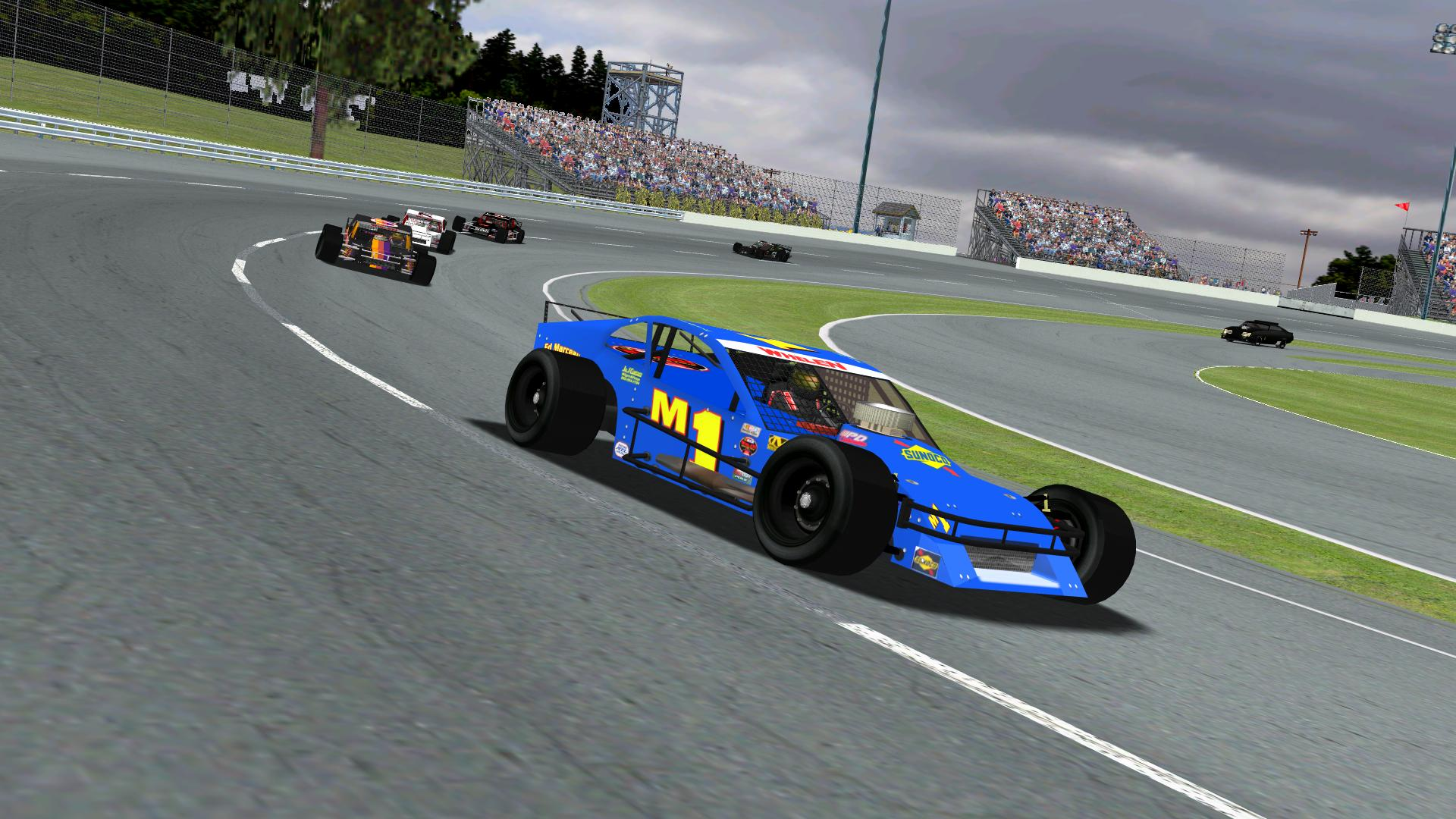 Rookiesrock leading the field through turns 1 & 2 after a late restart. (NHMA)