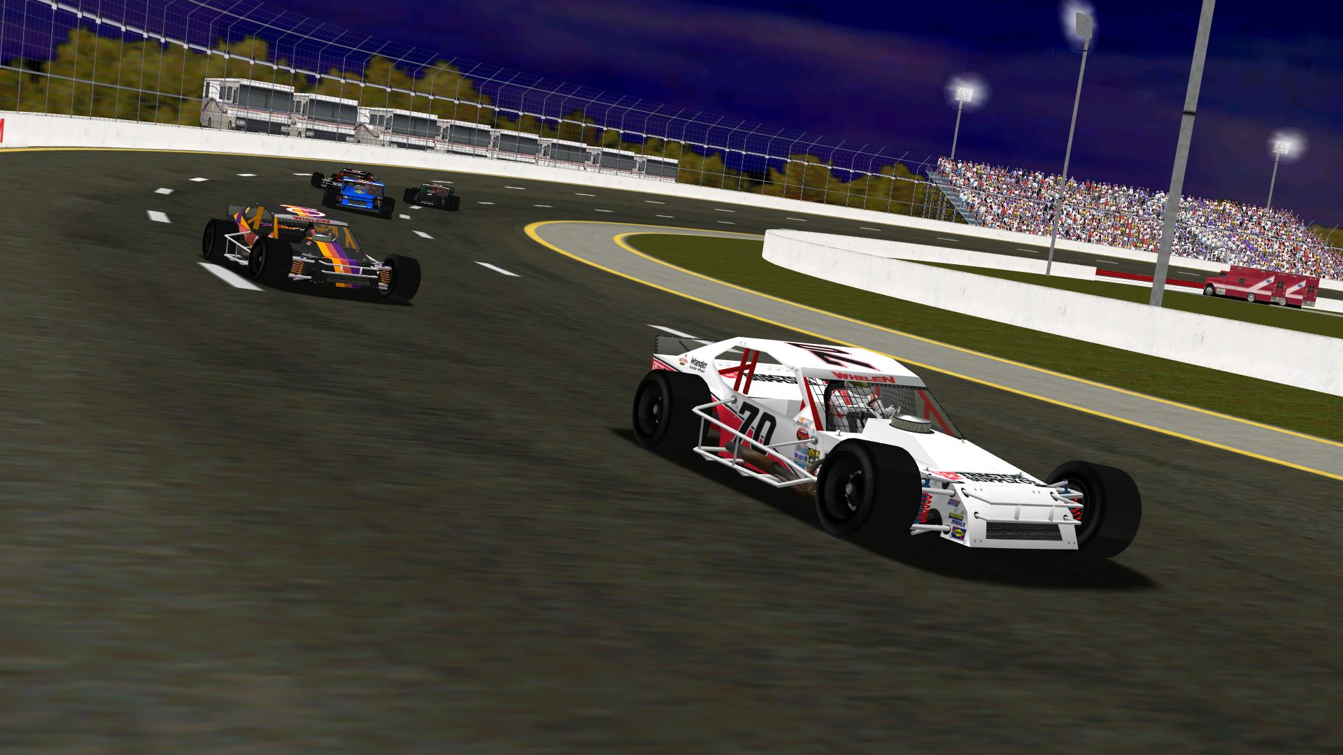 puttzracer chases lepage71 through turn two shortly after a restart. (NHMA)